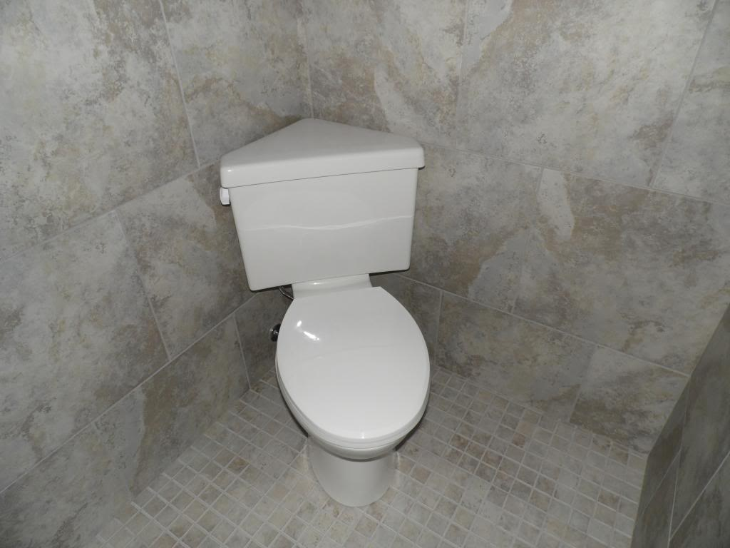 Saving space in your small bathroom with a corner toilet for Compact toilet for small bathrooms