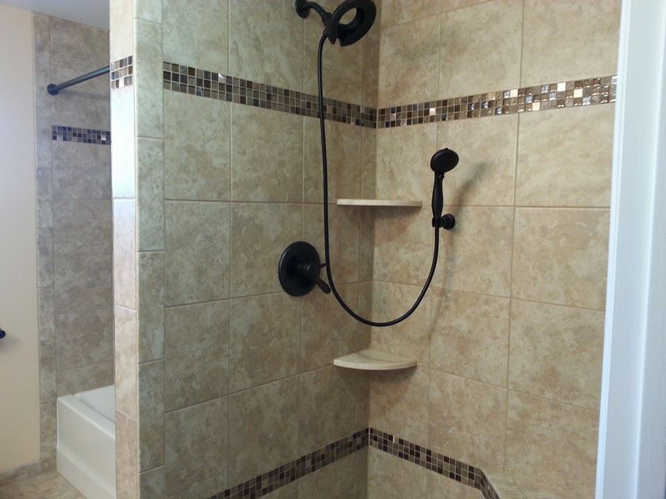Camp Hill, Pa Tiled shower with glass banners and granite cornershelves
