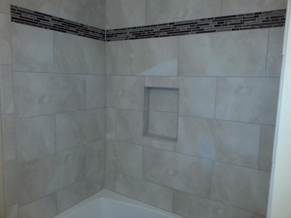 completed tile shower walls with accent banner in Marysville, Pa