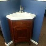 Corner sinks will open up unused space in your new bathroom.