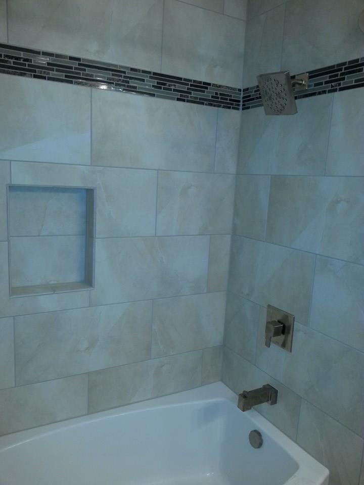 tile wall installation with a glass accent strip in Marysville, Pa