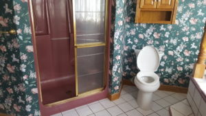 before picture of ugly bathroom and wallpaper in Juniata County