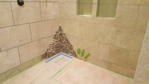 custom pebble installation in tile shower, harrisburg, Pa