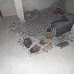 Tile Shower with Boulder Seat and Custom Pebble floor.