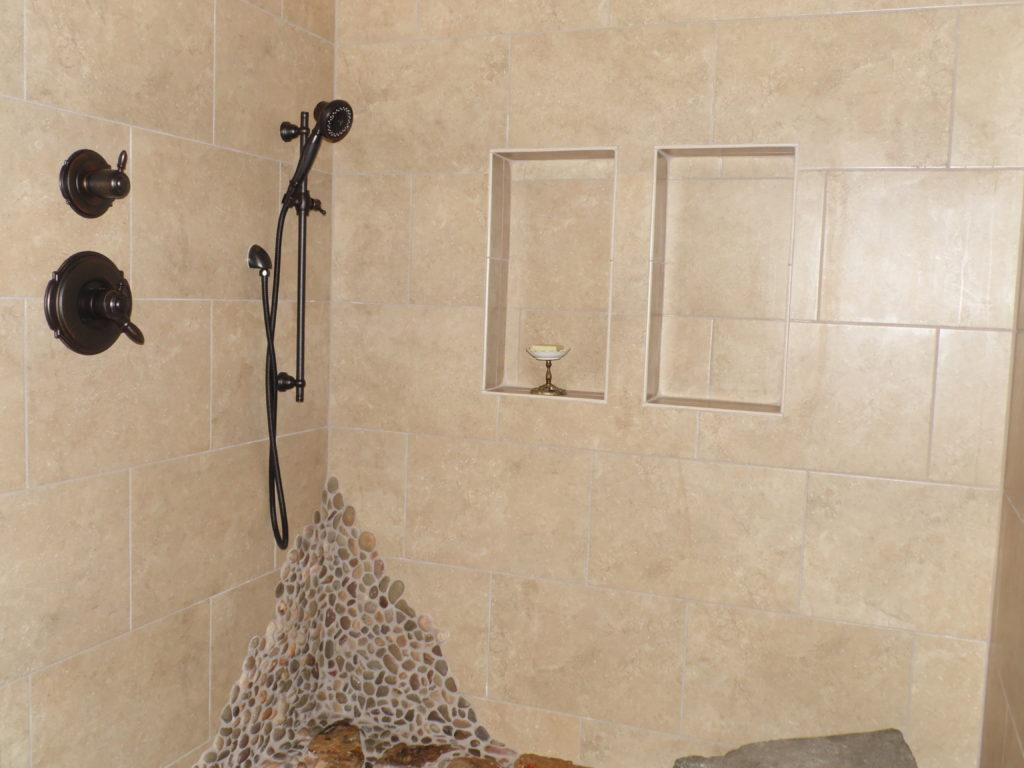 dual niches in tile bathroom